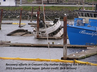 Photo of sunken boat in Crescent City Harbor following the March 11, 2011 tsunami from Japan (photo credit: Rick Wilson, CGS)